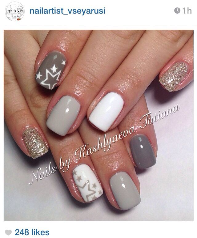 Nude nails with stars - I especially like the white nail with gold ...