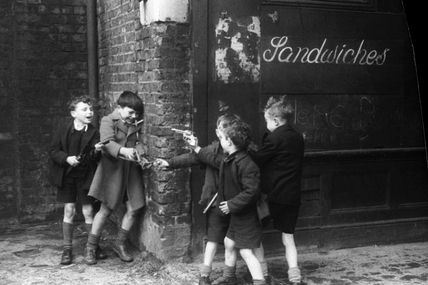 Boys playing Cops and Robbers in Cable Street, East London: 1951