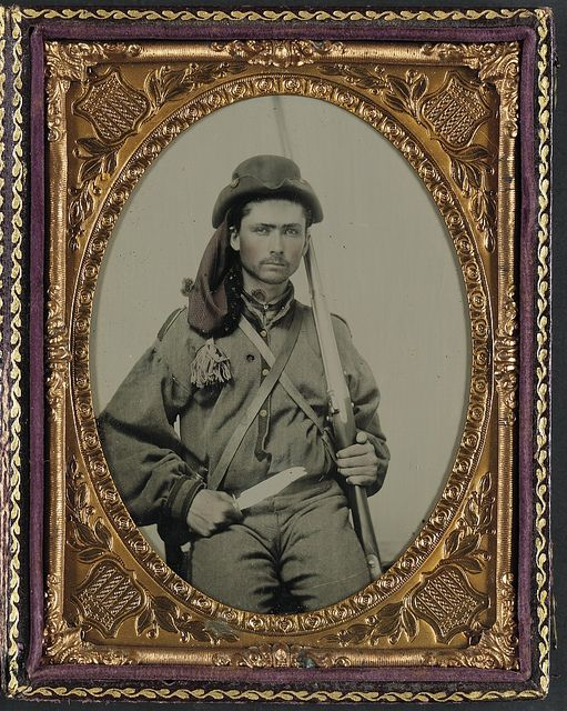 Unidentified soldier in Confederate infantry uniform with musket and Bowie knife(LOC)1861-1865: quarter-plate ambrotype, hand-colored