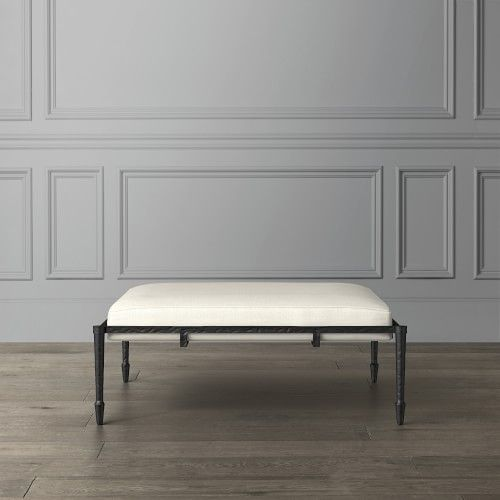 Serving as both a spacious coffee table and an inviting ottoman, this versatile piece offers the classic appeal of hammered metal with refined elegance. Crafted by skilled artisans, the durable base is set on tapered legs and inset with a thick solid-fill cushion for long-lasting comfort in any living space. 44