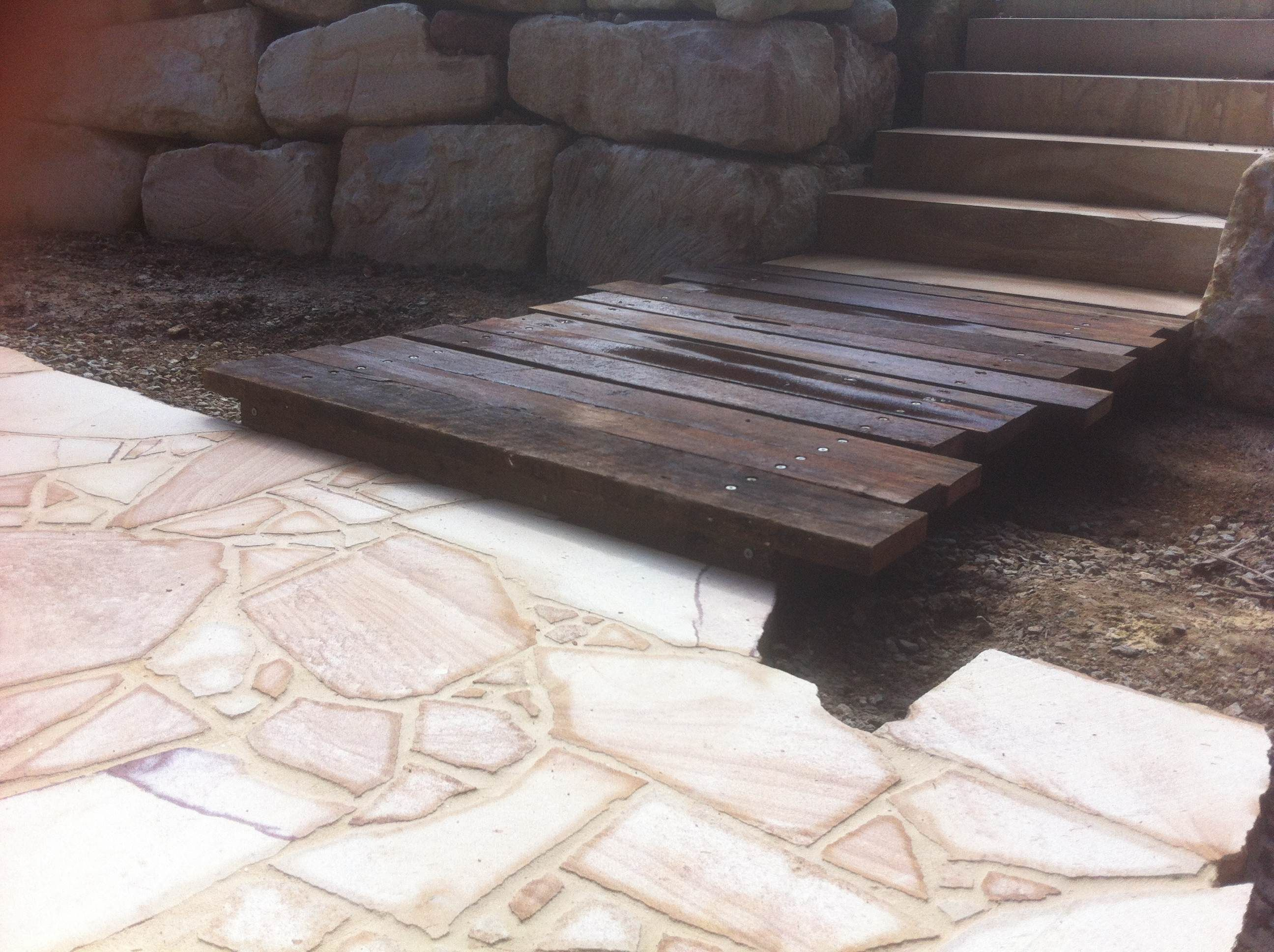 Landscaping Boulders Brisbane : Crazy paved sandstone pad and boulder retaining walls with