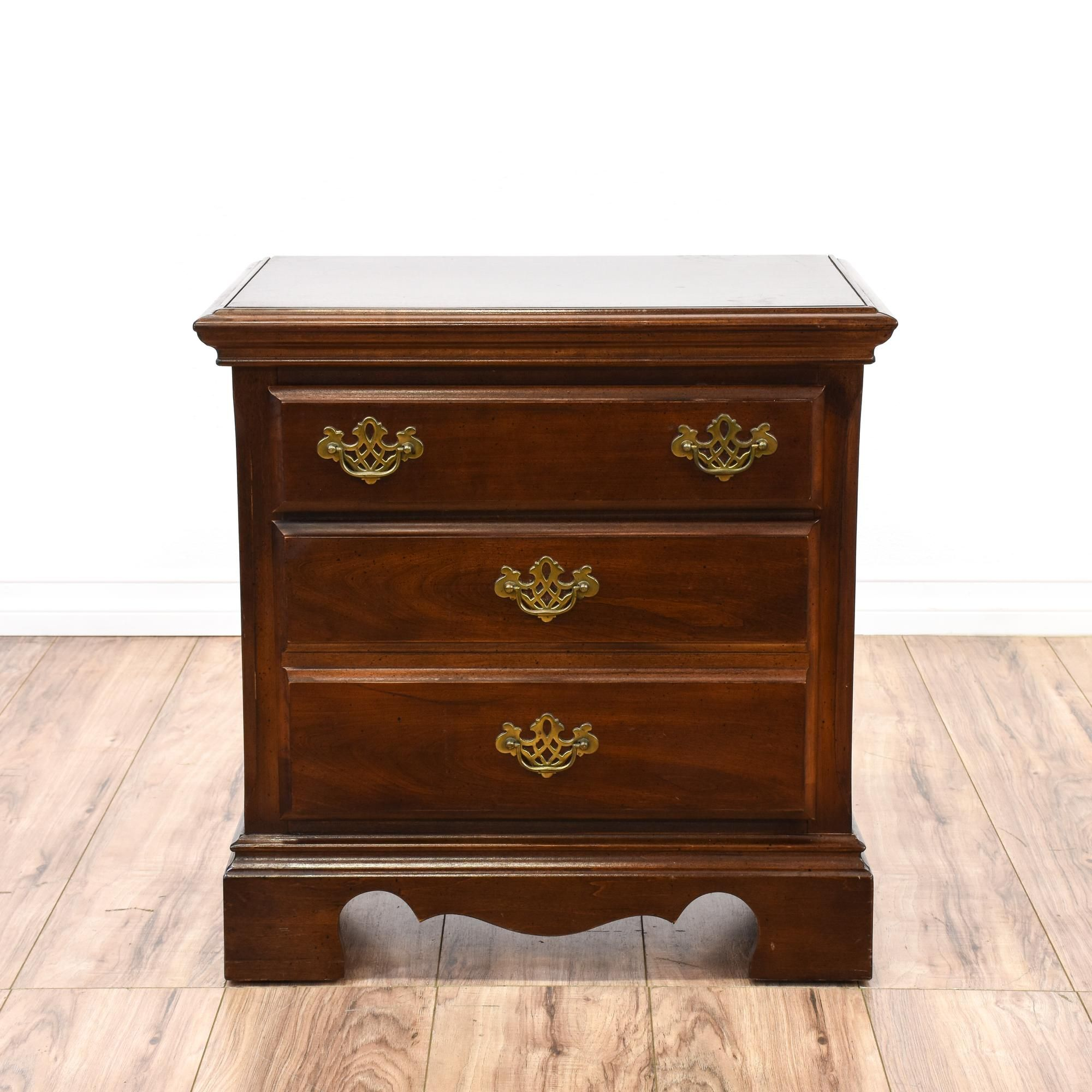 This nightstand is featured in a solid wood with a glossy cherry