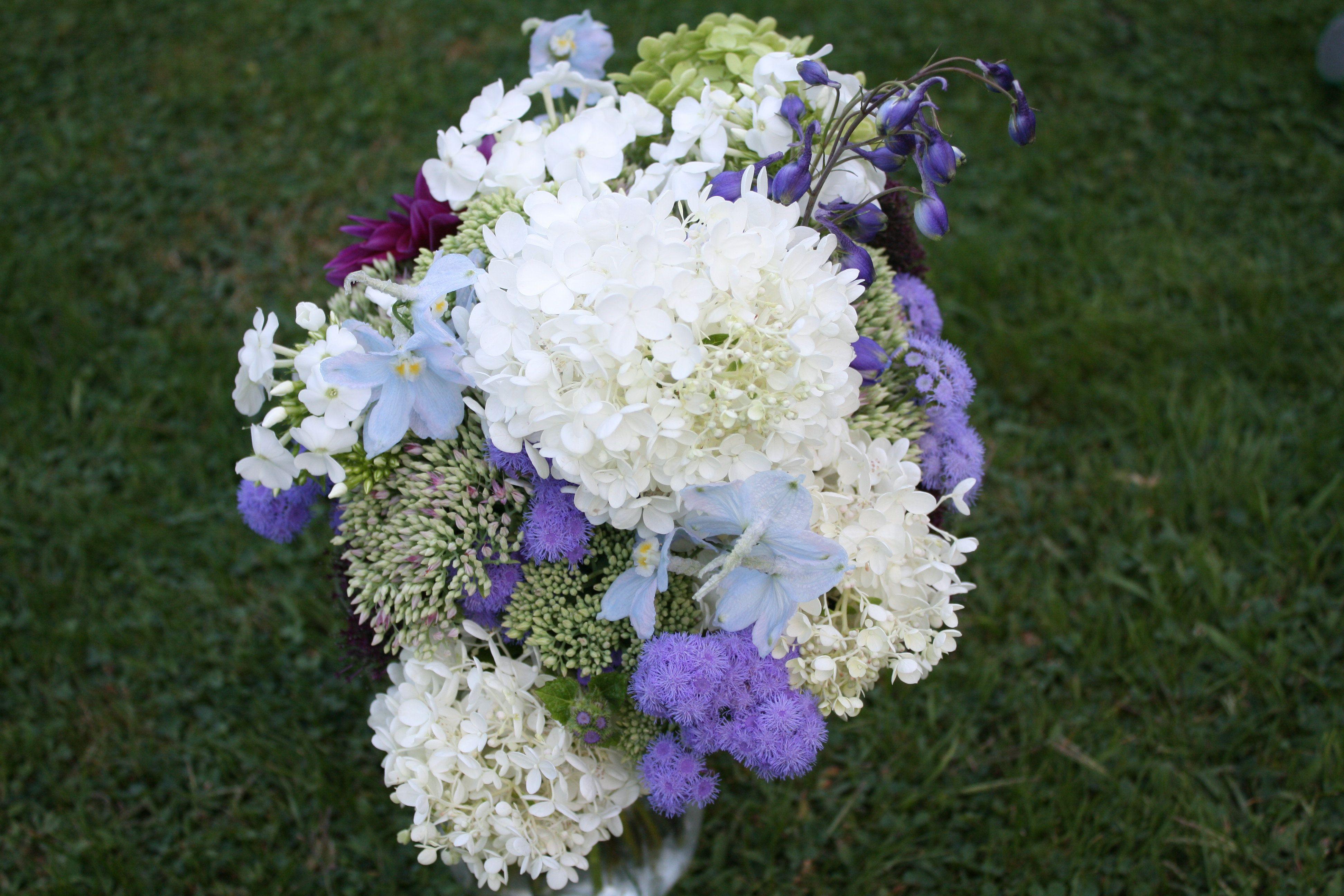 Hand tied bridal bouquet made with blue argeratum white phlox hand tied bridal bouquet made with blue argeratum white phlox purple trichillium blue altavistaventures Images