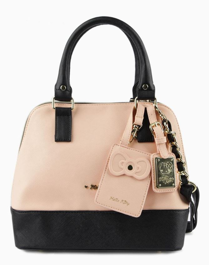 9c1a0ca6158c It s Hello Kitty love at first sight with this handbag. An elegant  combination of black and apricot crosshatch faux leather with a  three-quarter zip and ...