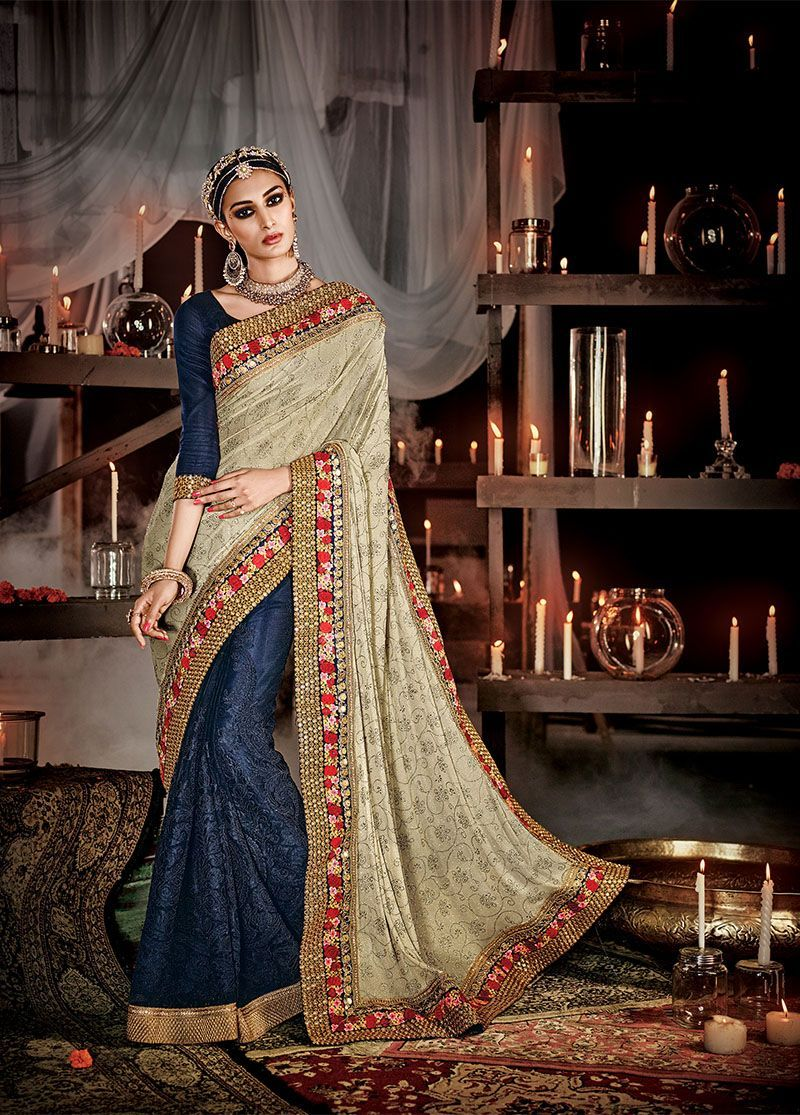 e65d3cc86a Splendid reception saree in combination of navy blue and cream. Designer  half-half saree with diamond work border and heavy cording work