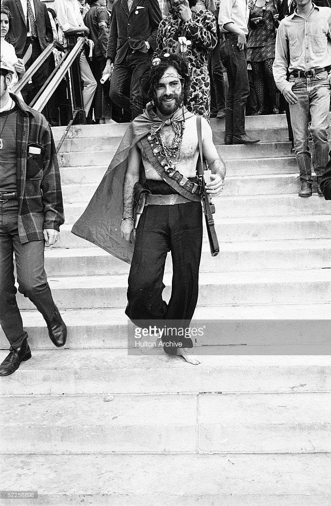 American Activist Jerry Rubin Smiles As He Walks Down The Steps