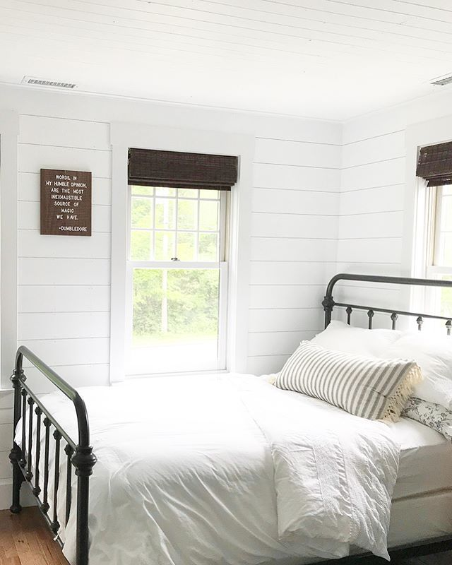 Simple White Farmhouse Bedroom With White Shiplap And Black Metal Bed Remodel Bedroom White Bedroom Decor Simple Bedroom
