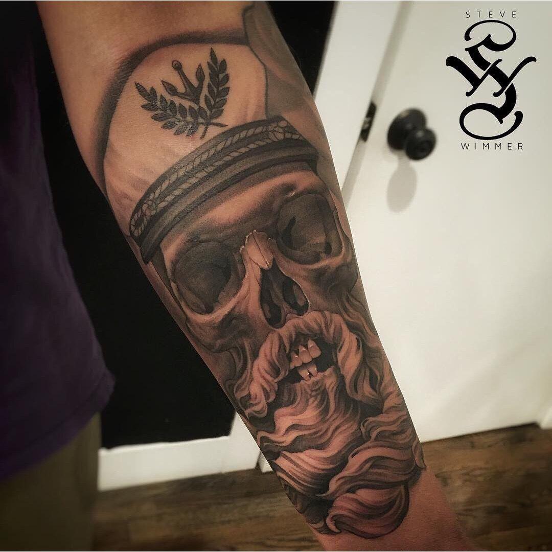 Realistic skull tattoo by steve wimmer at guru tattoo in