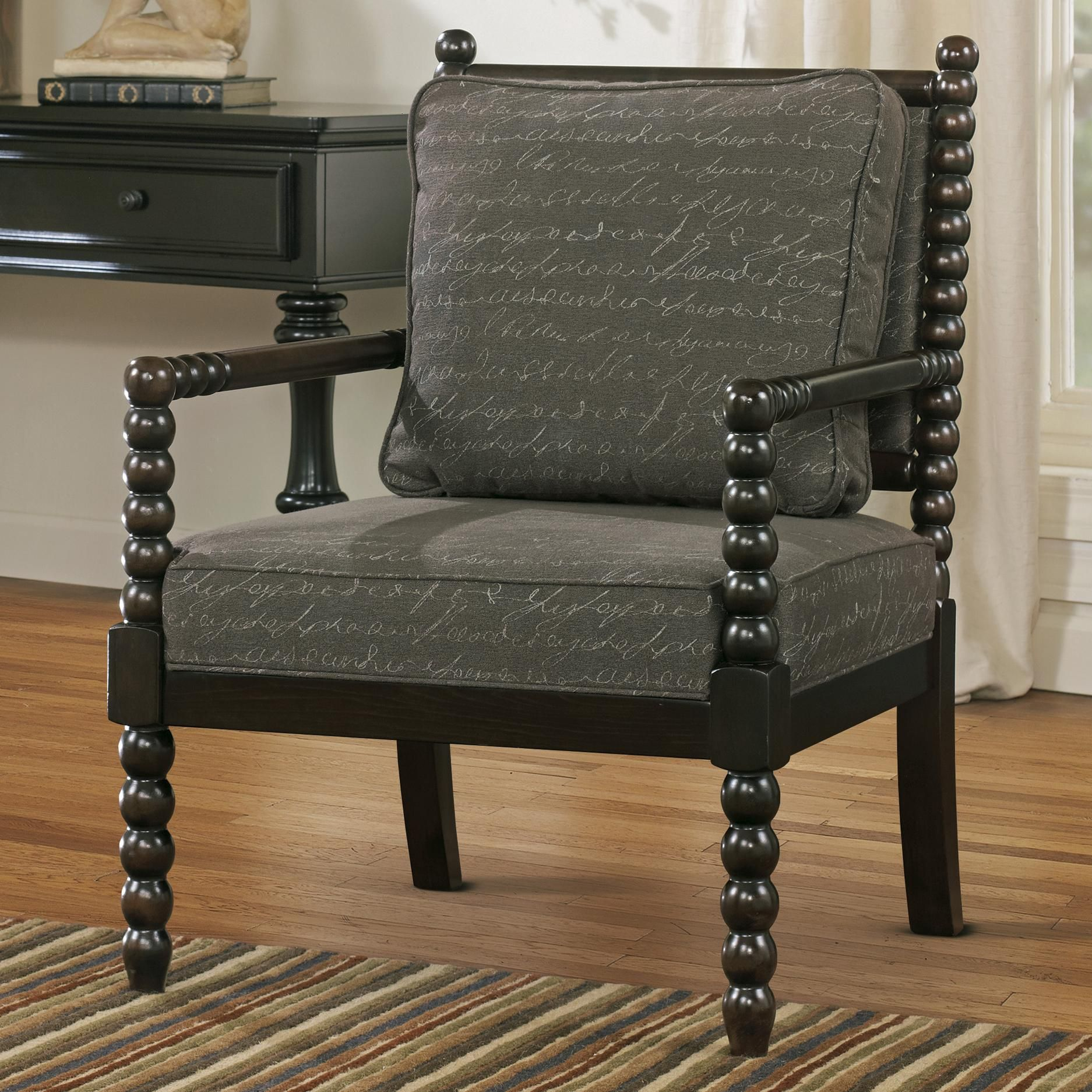 Accent chair in script fabric with spool turned legs and arms