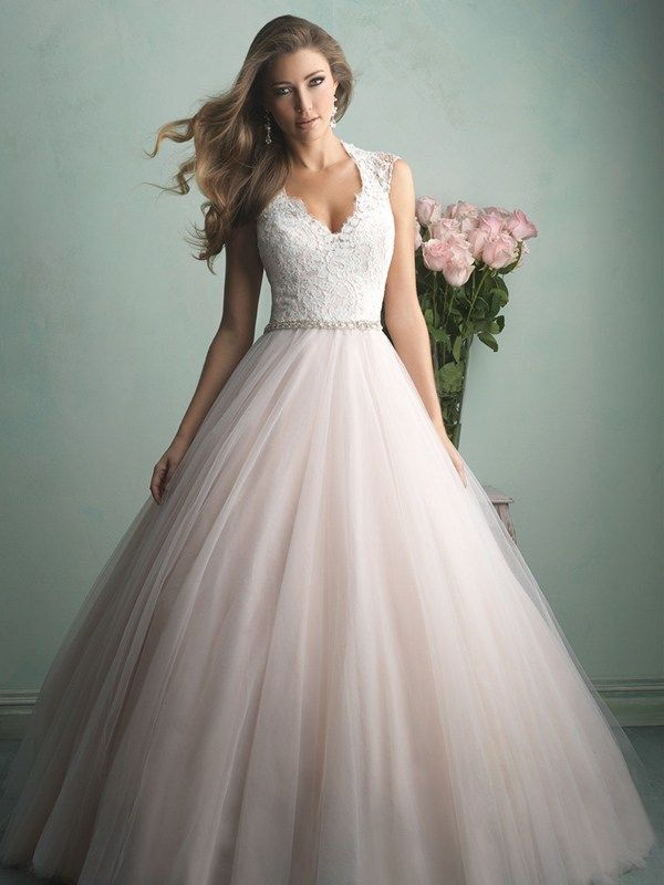 9162 Allure Bridals - This is truly the bridal gown of a princess — a gauzy tulle skirt topped with an incredibly gorgeous lace bodice and a sheer, beaded back.