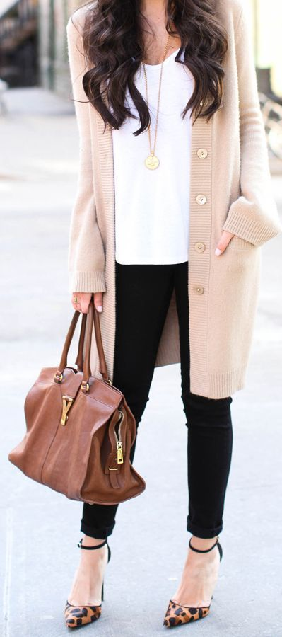 Rock a pink shawl cardigan with black skinny jeans to create a chic, glamorous look. Add a little glam to your getup and throw in a pair of brown leopard leather pumps.  Shop this look for $149:  http://lookastic.com/women/looks/pumps-and-tote-bag-and-skinny-jeans-and-shawl-cardigan-and-tank/4090  — Brown Leopard Leather Pumps  — Brown Leather Tote Bag  — Black Skinny Jeans  — Pink Shawl Cardigan  — White Tank