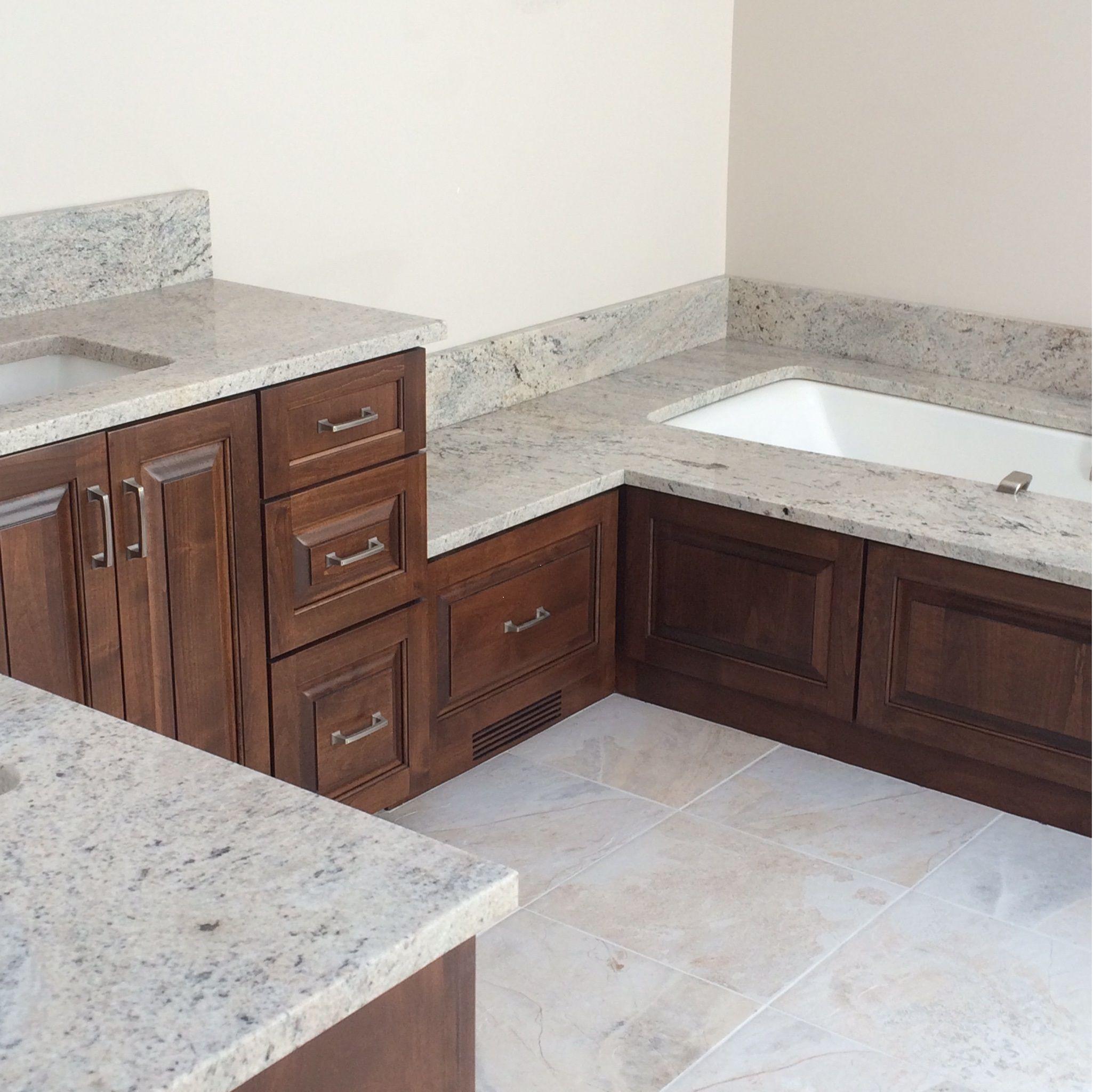 Semi custom cabinets topped with celo de marfil granite sagent