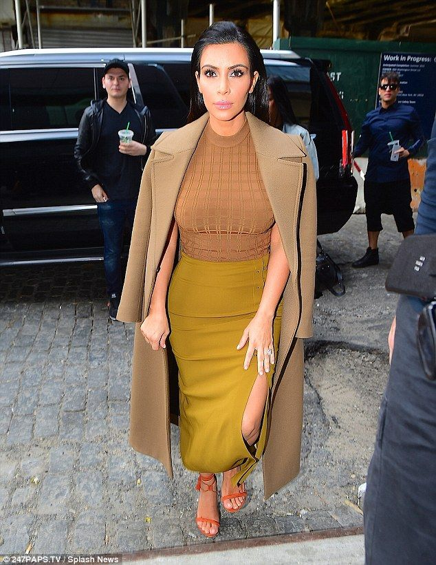 Surrounded: Stylish Kim caused a furor of excitement among fans earlier on Wednesday while...