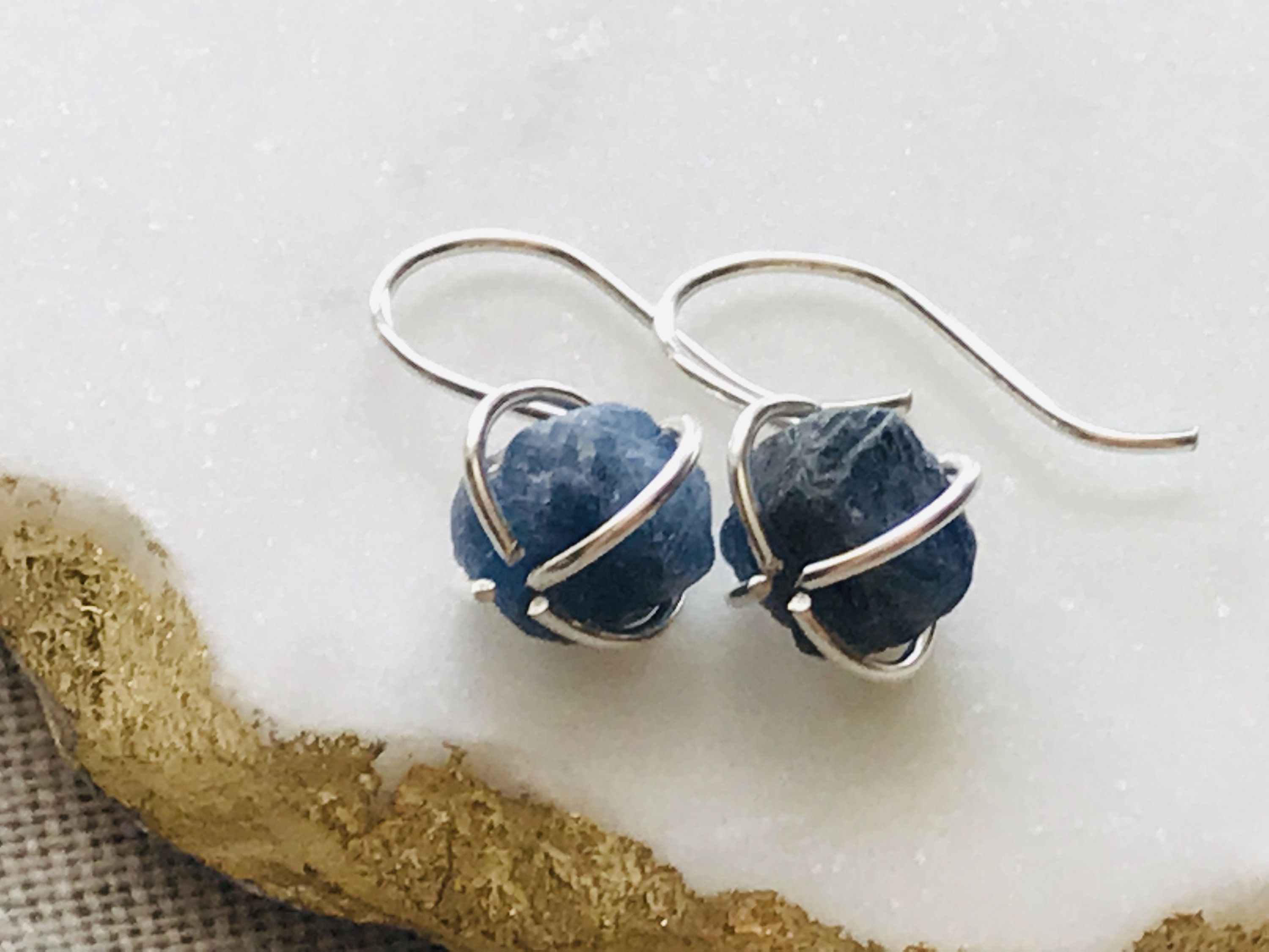 A beautifully natural uncut rough sapphire stone set in a