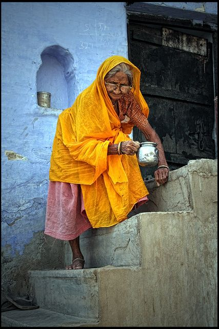 Yellow on light blue - Women of Bundi - Rajasthan. Where is she going? What is she doing? What has she seen in her life? What's her name?