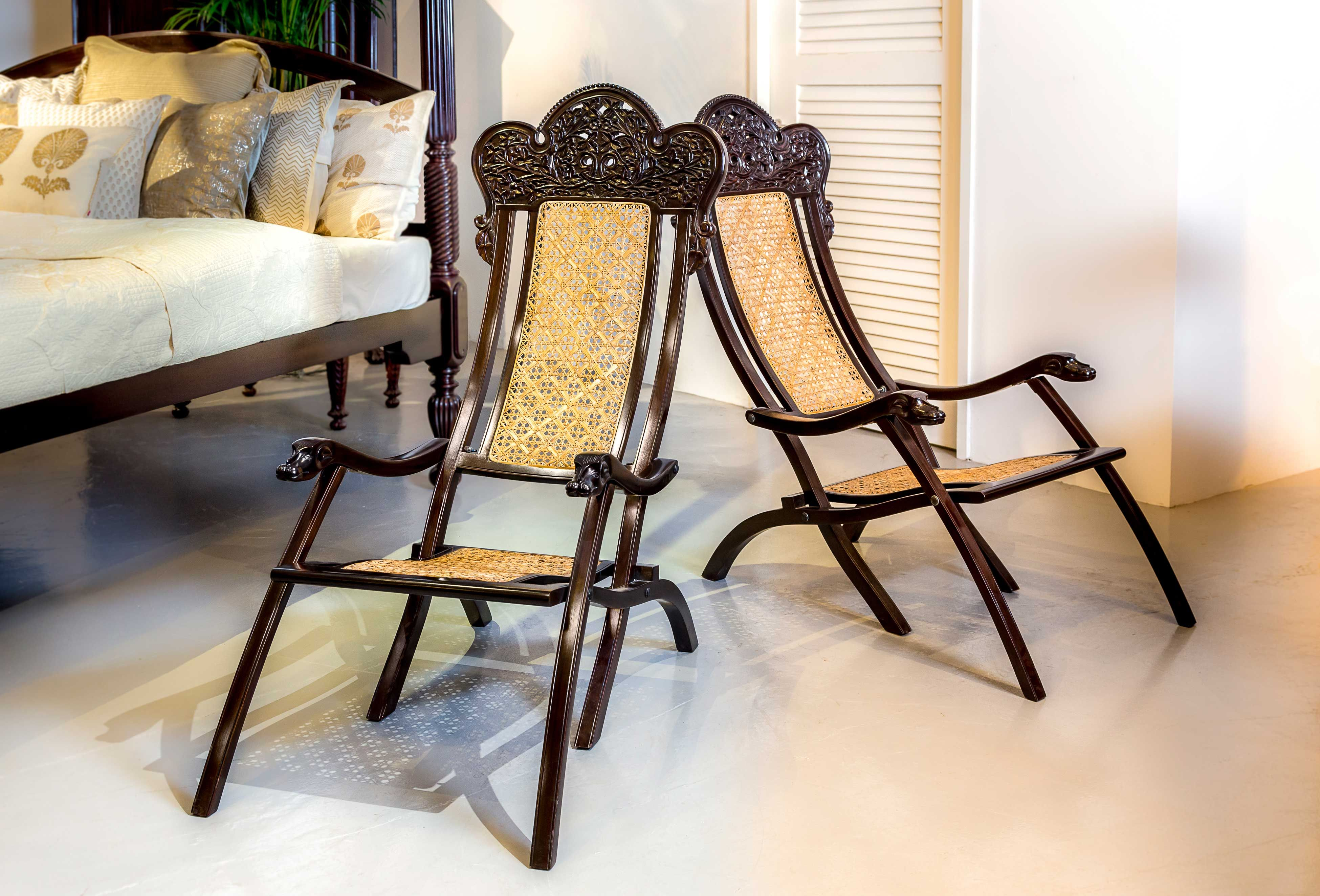 A pair of Portuguese colonial rosewood folding chairs Each chair