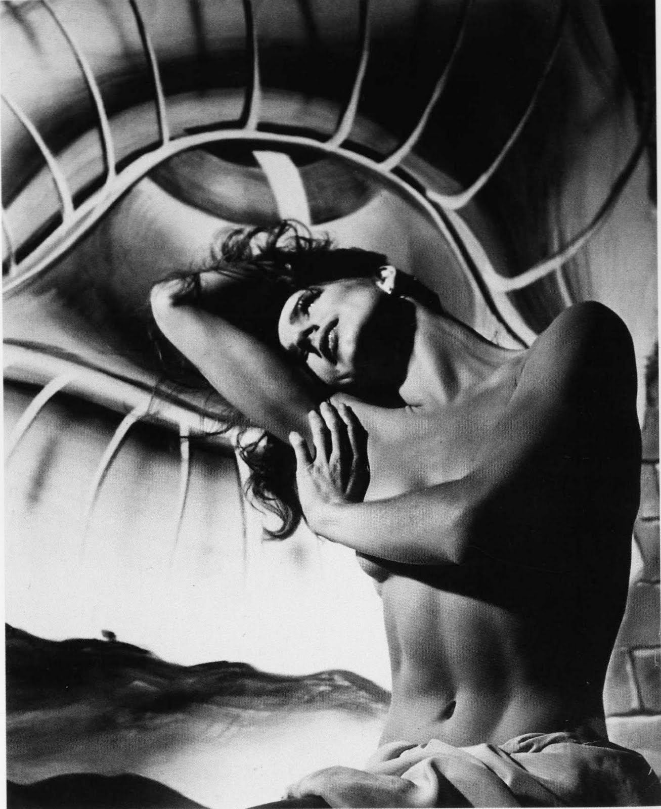 The unnamed dancer is posing before part of Salvador Dali's backdrop for Hitchcock's Spellbound