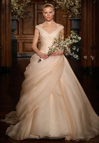 Blush Silk Organza ball gown. Silhouette: Ball Gown Neckline: Off-the-Shoulder Waist: Dropped Gown Length: Floor Sleeve Length: Sleeveless Train Style: Attached Train Length: Chapel Fabric: Silk Organza Special Features: V-Back Color: Blush, Pearl, Ivory Size: 2 - 20 Price: $$$$$