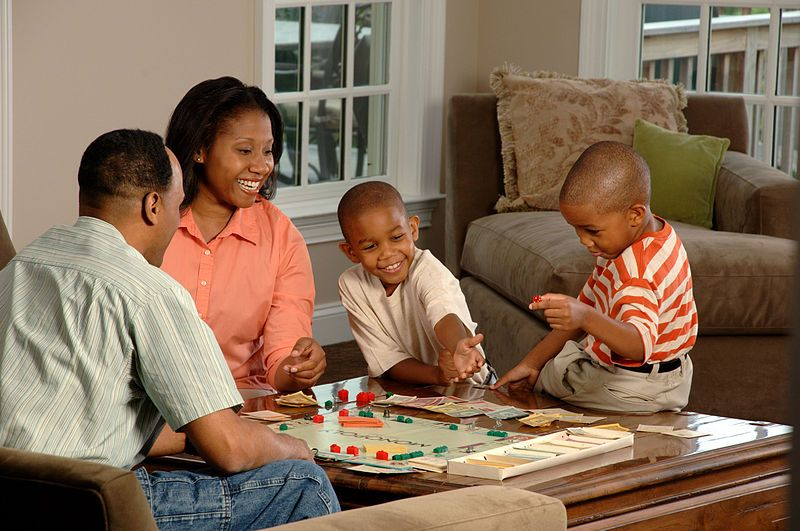 Image result for black family playing games a home