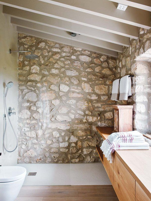 Majorcan countryside home exudes charm and character is part of Countryside house, Majorcan, Stone bathroom, Restroom remodel, Stone shower, Home accents - Just outside of the Majorcan town of Llubí, this Mediterranean countryside home retains the flavor of old while expressing a rich contemporary language