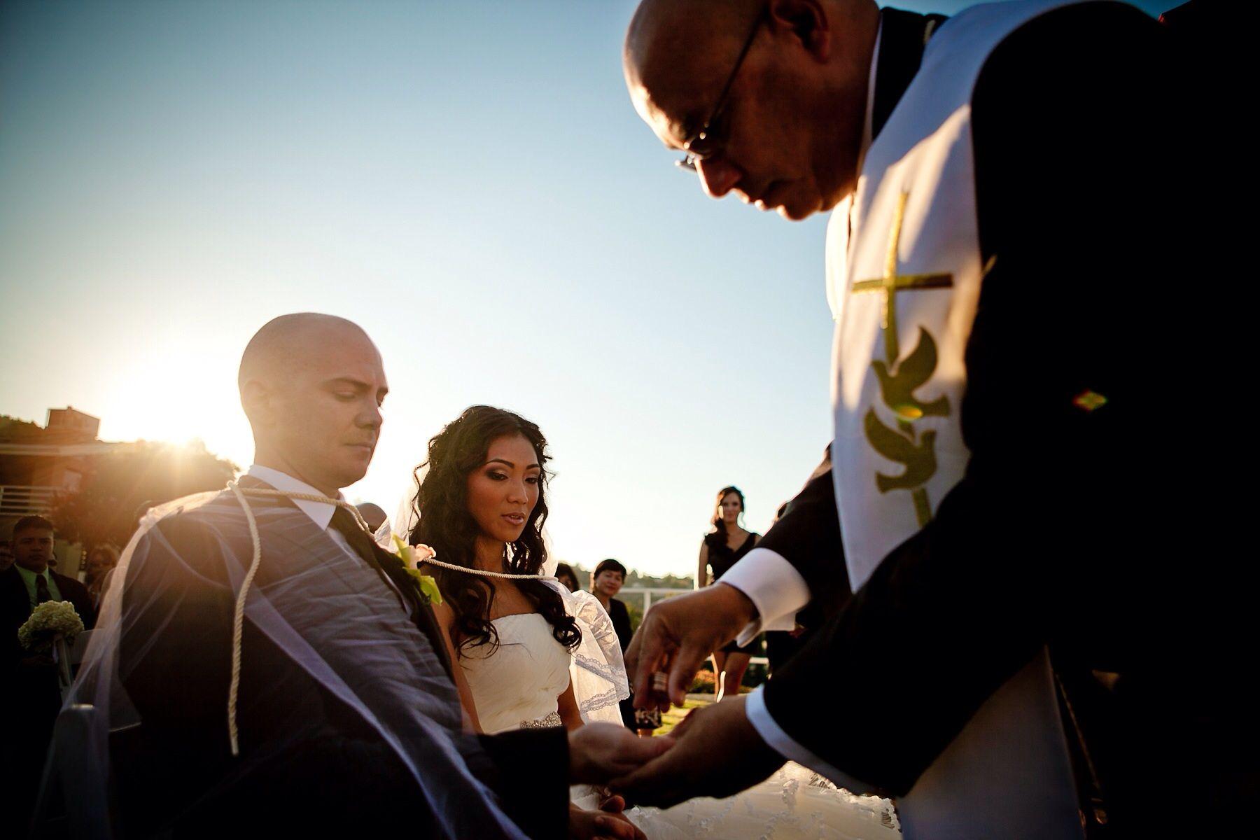 Veil, cord and coin ceremony Catholic wedding ceremony