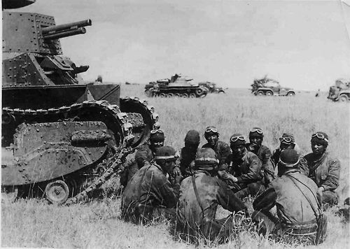The crew of a Japanese Type 89 I-Go tank being briefed on ...