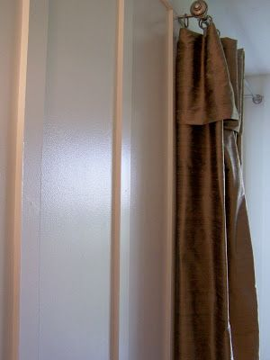 Turn the last curtain clip so that it hangs on the bracket instead of the rod.  This keeps your curtain at the end of the rod - via A Soft Place