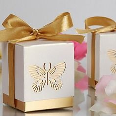 Wedding Favors - $6.19 - Butterfly Laser-cut Cuboid Favor Boxes With Ribbons (Set of 12)  http://www.dressfirst.com/Butterfly-Laser-Cut-Cuboid-Favor-Boxes-With-Ribbons-Set-Of-12-050013596-g13596