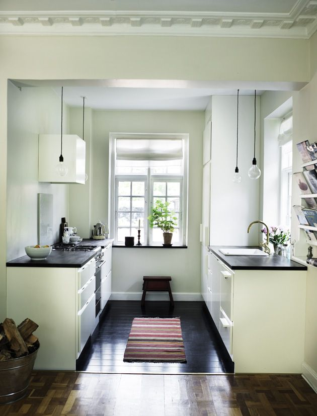 I love looking at this simple lovely kitchen. Nothing like dark grey ...