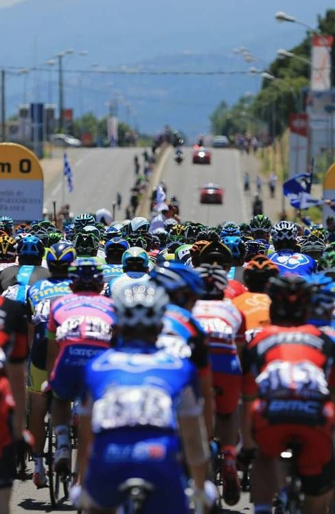 BASTIA, FRANCE - JUNE 30: The peloton arrive at the 0 kilometre mark as they prepare to start stage two of the 2013 Tour de France, a 156KM road stage from Bastia to Ajaccio, on June 30, 2013 in Bastia, France. (Photo by Doug Pensinger/Getty Images) (via Cycling - Photo Gallery - Yahoo! Sports)