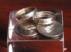 My dad showed me how to do this I wear mine with my wedding band. It's cool, because the wording on the edge of the coin ends up in the middle of the ring! Do you have a quarter from 1964 or before? If you do, it is made of silver. You can turn that coin into a nice silver band using a spoon, a drill, and a metal file. (And no, it's not illegal.)