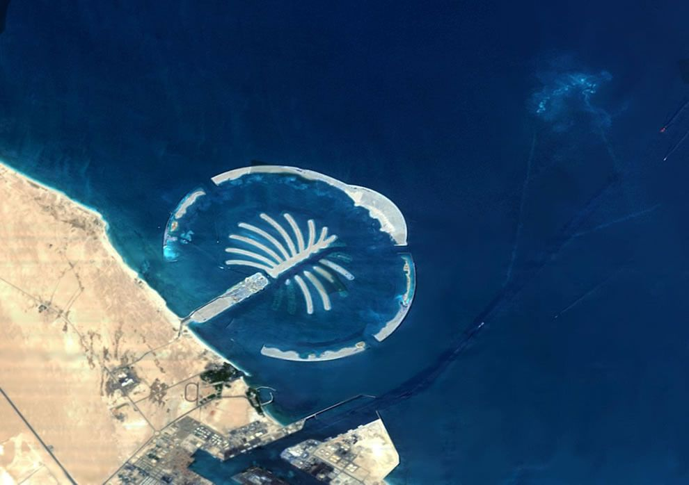 The Second Palm Island, Dubai  The islands are being built in shallow waters of the wide contintental shelf found off Dubai, using millions of cubic metres of sand dredged from the approach channel to the Jebel Ali port ? seen here adjacent to the artificial island named after it. Photo by © SSTL through ESA