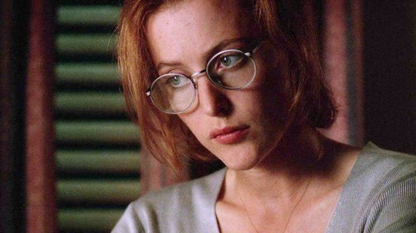 Gillian Anderson as Dana Scully looking wearing eyeglasses with thin frames