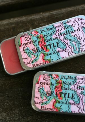 Lip Balm feat. Seattle Map by Laura Bee Designs. 1899 map on an old school slider tin filled with all-natural balm.