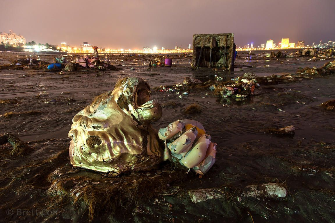 Photo of Body parts from idols wash up on Chowpatty Beach in Mumbai, India after the Gane…