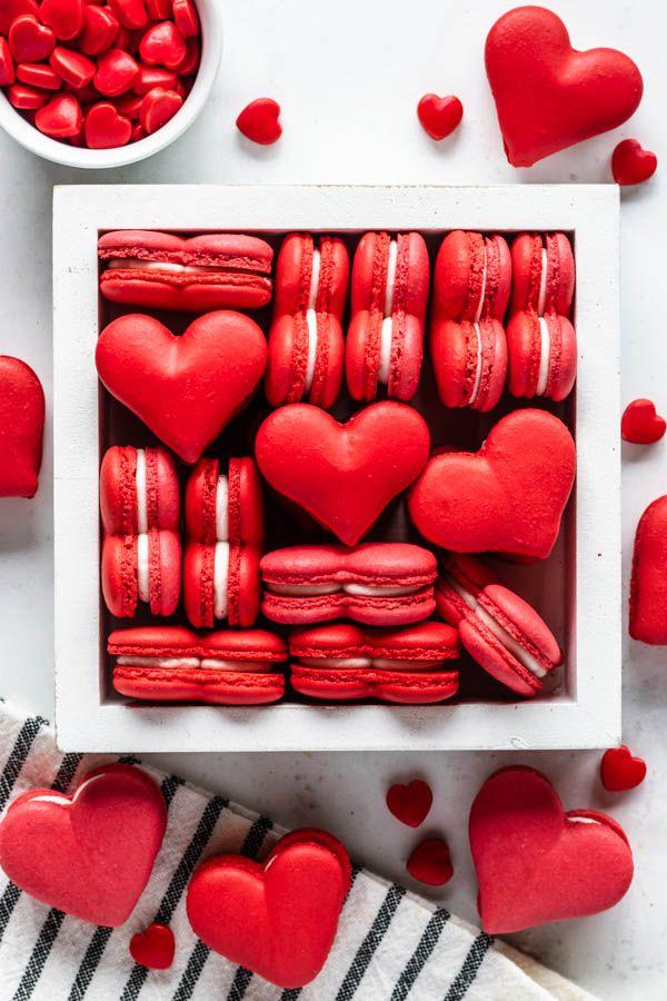Heart Shaped Macarons #heart #macarons #frenchmacarons #macaron #cookies #glutenfree #glutenfreecookies #valentinesday #valentinescookies #redmacarons #creamcheesefrosting