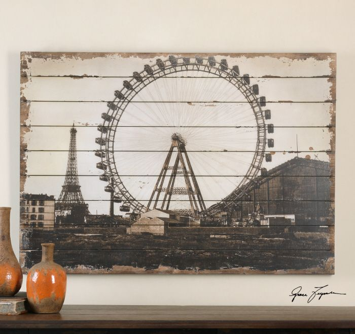 Uttermost Roue de Paris. This oil reproduction has been printed on a wooden backboard and features a sand texture finish. Edges around the image have been distressed.