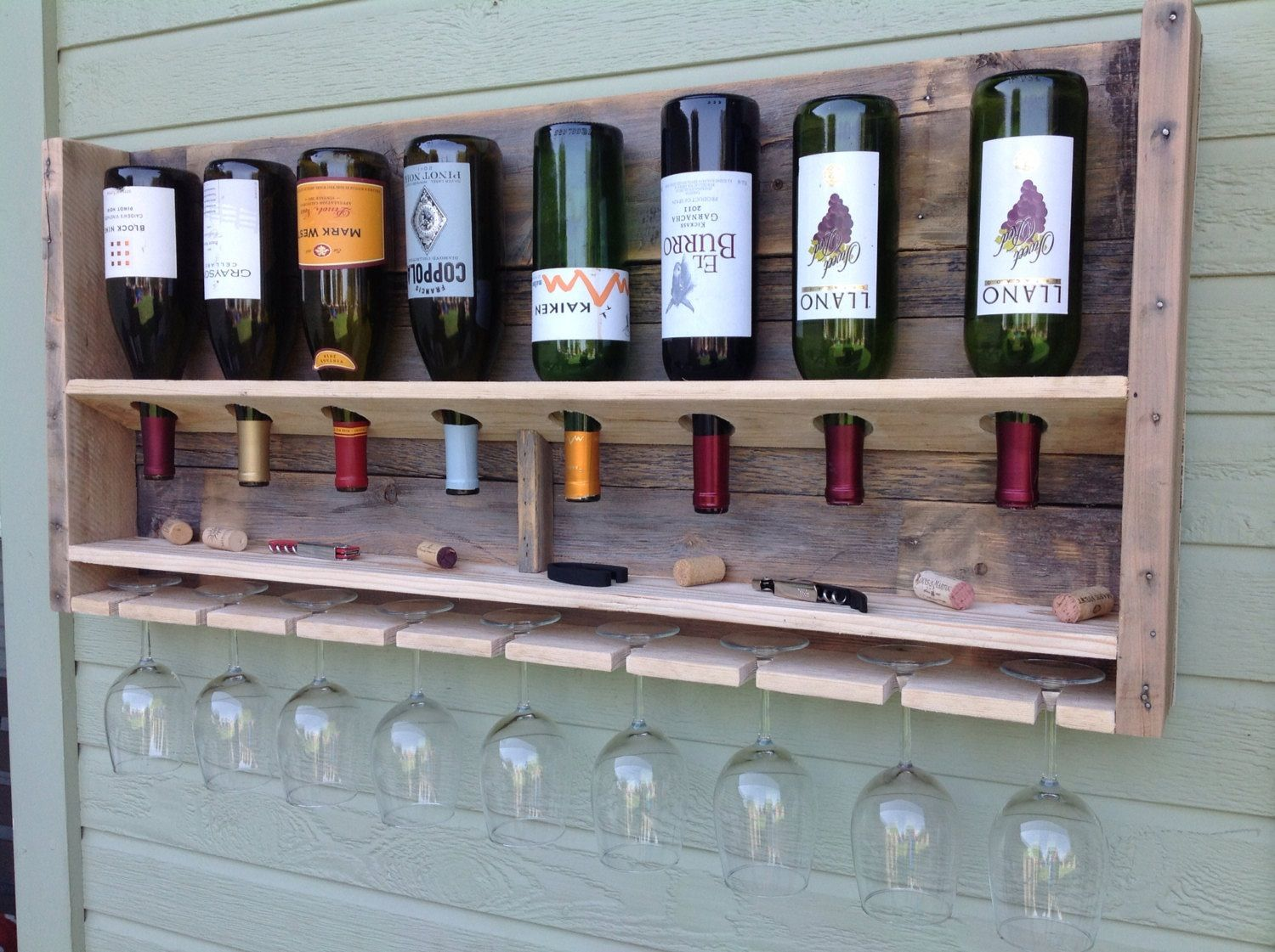 wine rack made from recycled wood pallet school auction. Black Bedroom Furniture Sets. Home Design Ideas