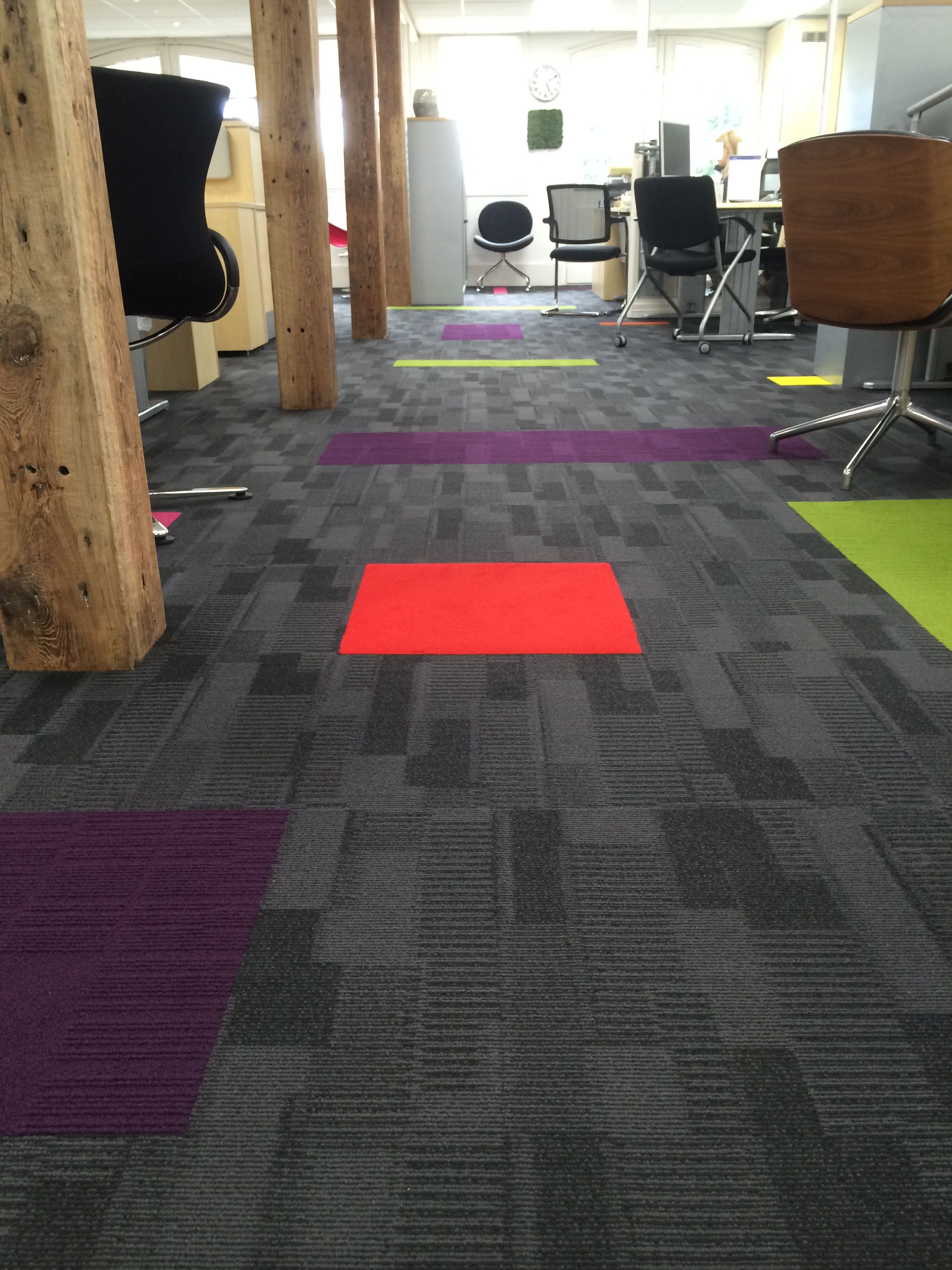 Linear Flooring Design Using Interface Tiles Installed By Creed