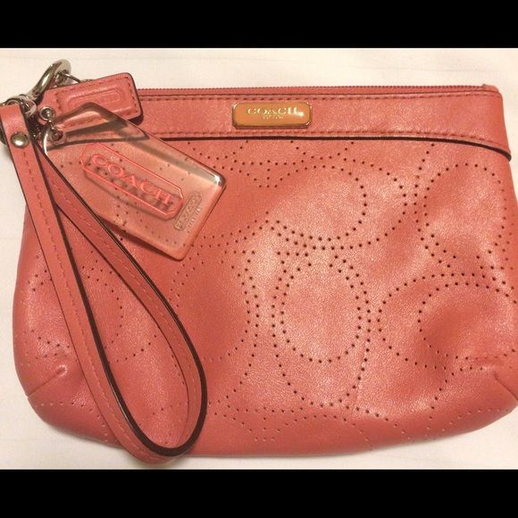 5b7e2b386199 COACH PERFORATED LEATHER WRISTLET Salmon/pink color. Perforated CC ...