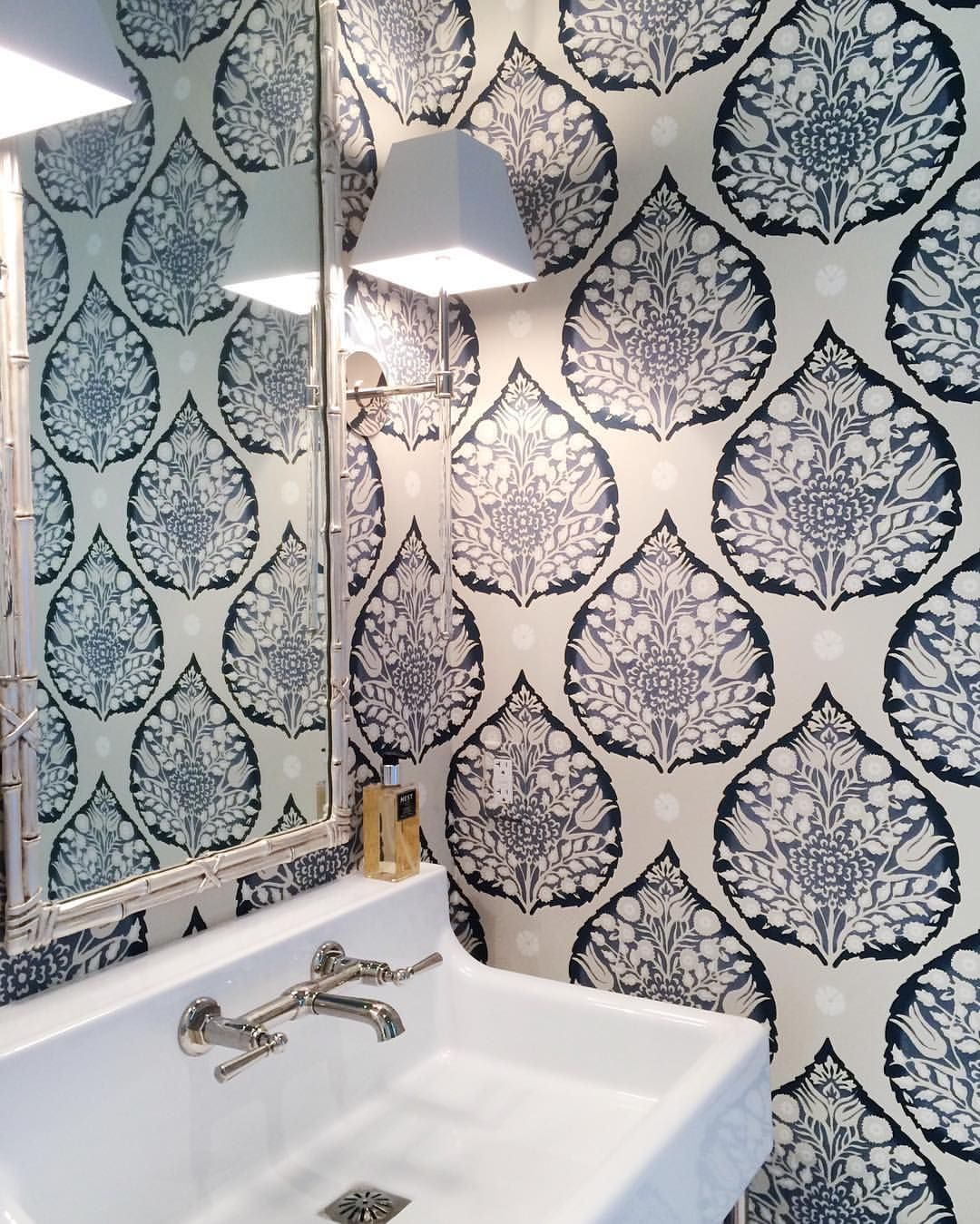 Galbraith and Paul Lotus wallpaper in a powder room by McCann Design Group
