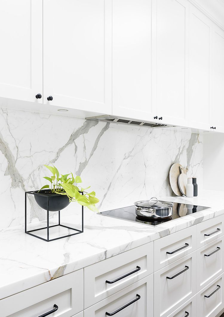 White Marble Backsplash And Counter Kitchen Via Home Adore White