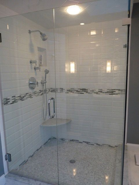 Modern tile glass shower look at the accent strip for for Bathroom designs companies