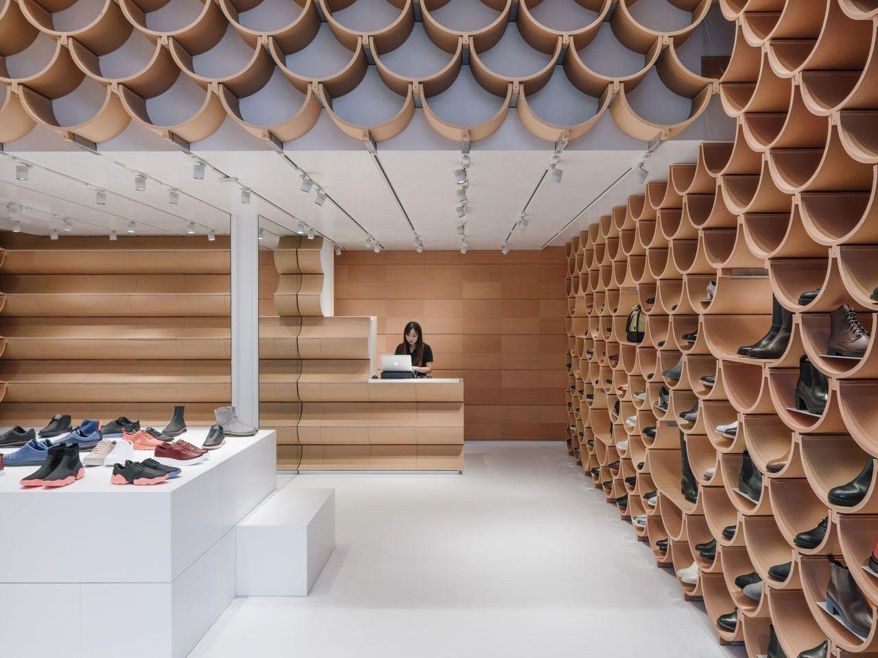 Roof tiles shoe displays in Camper store by Kengo