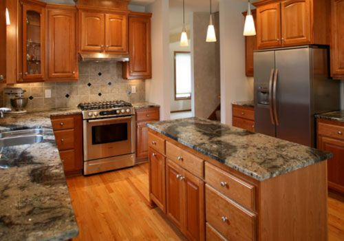 twin cities kitchen features custom cherry wood cabinets. Black Bedroom Furniture Sets. Home Design Ideas