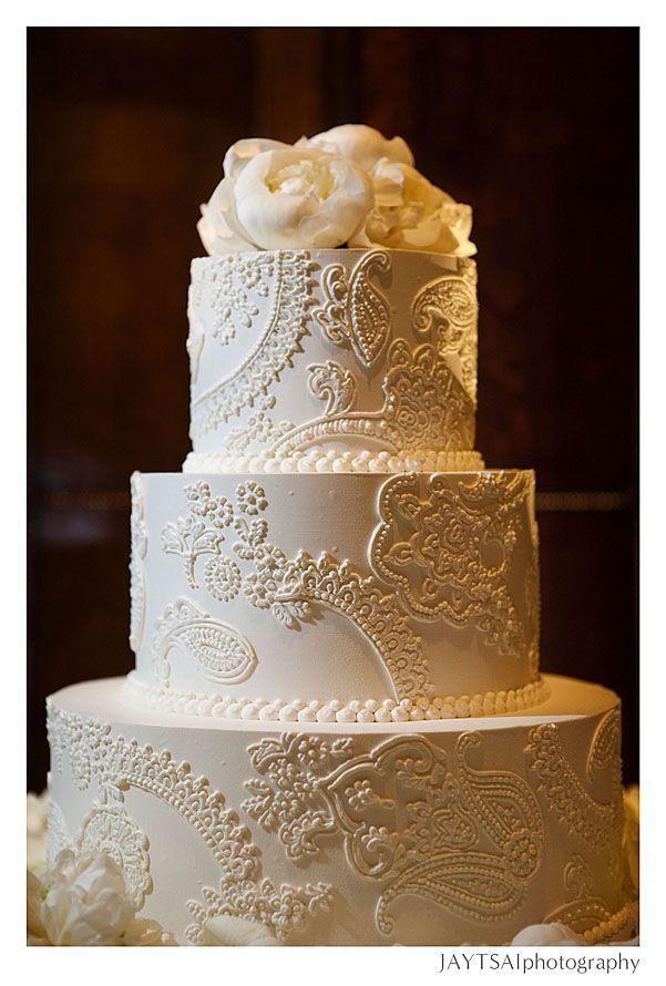 Tone on tone damask wedding cake.