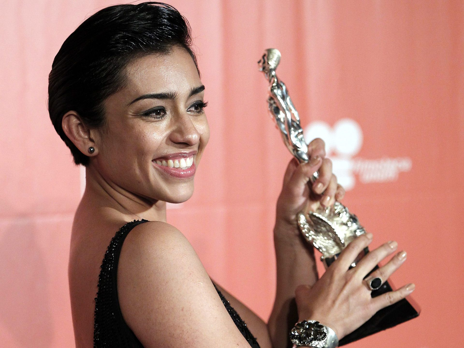 Adriana paz shows off her award after winning best actress during adriana paz shows off her award after winning best actress during the 57th ariel awards in mexico city jose mendez european pressphoto agency fandeluxe Choice Image