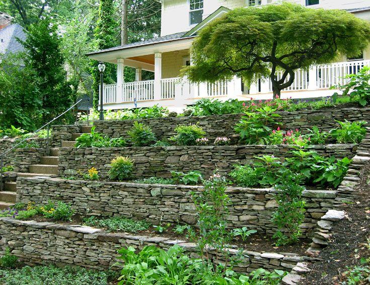 Hillside Landscaping Tiering An Existing Rock Wall Hillside