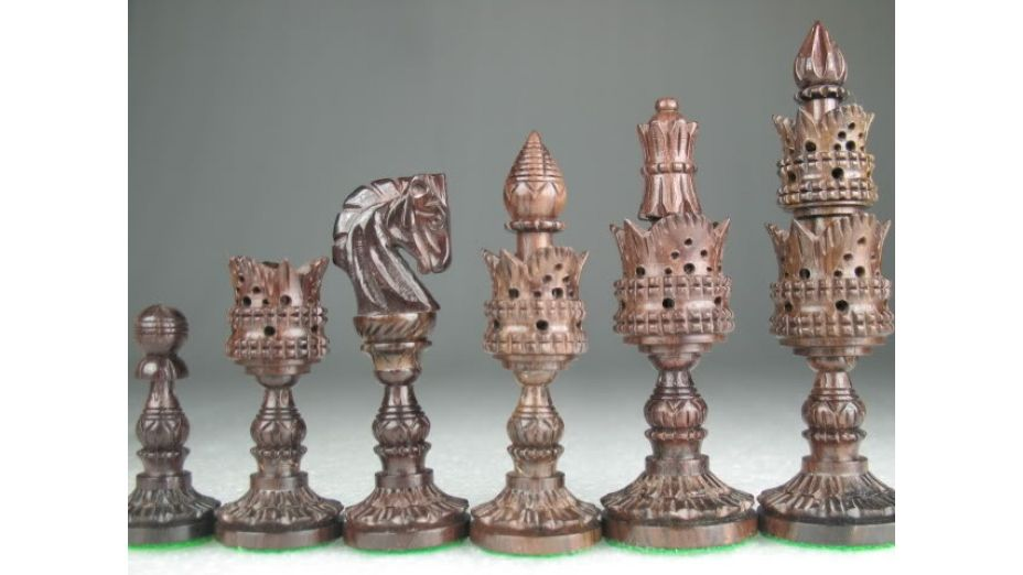 Handcarved Lotus Chess Set Rose Wood. http://www.chessbazaar.com/chess-pieces/economy-chess-pieces/chess-set-rose-wood-free-shippping.html