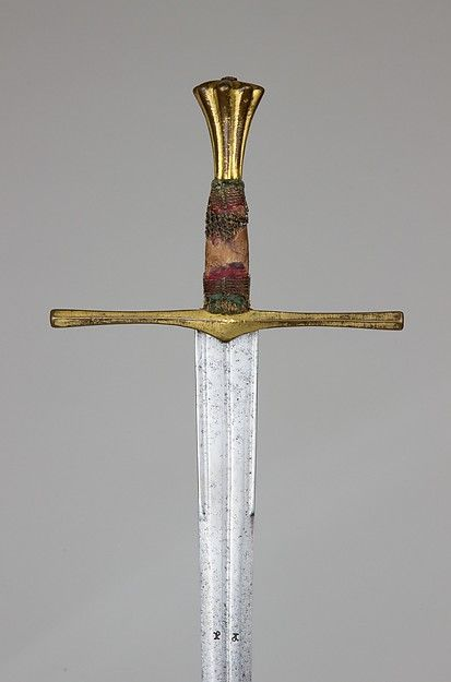 This early sword is one of the few to retain fragments of its original grip bindings, here consisting of red and green silk. The stiff acutely pointed blade is designed to pierce the gaps between the plates of an opponent's armor